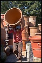 Man carrying a heavy pot, Tonala. Jalisco, Mexico ( color)