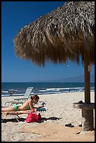Woman in swimsuit reading on beach chair, Nuevo Vallarta, Nayarit. Jalisco, Mexico (color)