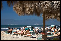 People lying on beach chairs, Nuevo Vallarta, Nayarit. Jalisco, Mexico (color)