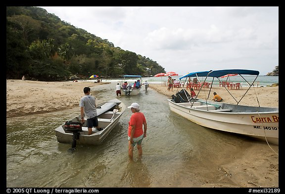 Boats moving from lagoon to ocean via small channel,  Boca de Tomatlan, Jalisco. Jalisco, Mexico (color)