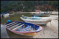 Small boats beached in a lagoon in fishing village, Boca de Tomatlan, Jalisco. Jalisco, Mexico (color)
