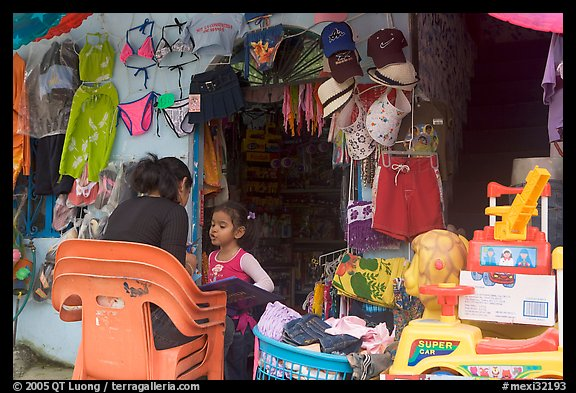 Woman and girl outside a store,  Boca de Tomatlan, Jalisco. Jalisco, Mexico (color)