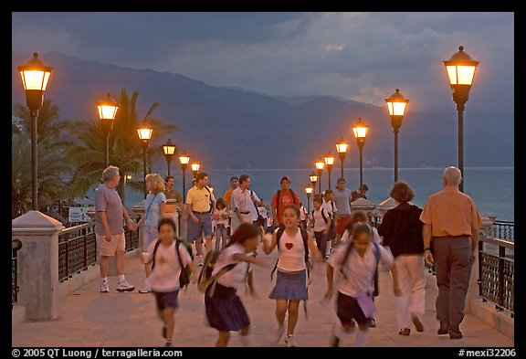 Children running on footbridge above Rio Cuale at dusk, Puerto Vallarta, Jalisco. Jalisco, Mexico (color)