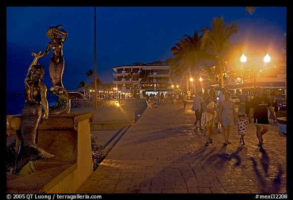 People strolling on the Malecon at night, Puerto Vallarta, Jalisco. Jalisco, Mexico (color)