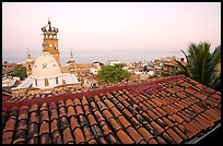 Tiled rooftop and Cathedral, and ocean at dawn, Puerto Vallarta, Jalisco. Jalisco, Mexico