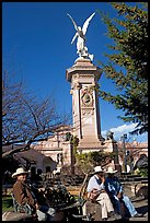 Men wearing cow-boy hats sitting in Garden of Independencia. Zacatecas, Mexico ( color)
