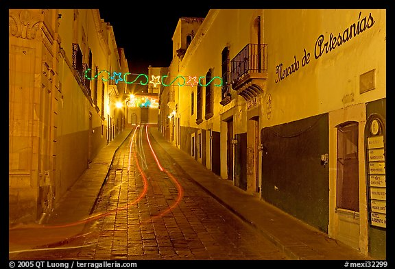 Uphill paved street by night with light trail. Zacatecas, Mexico (color)