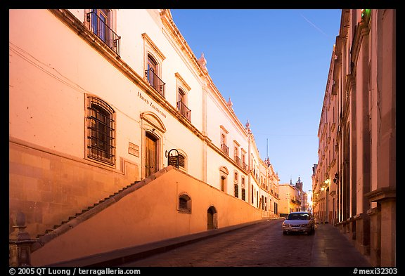 Car in street at dawn with Zacatecas Museum. Zacatecas, Mexico (color)