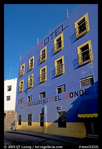 Hotel restaurant building painted bright blue and yellow. Guanajuato, Mexico (color)
