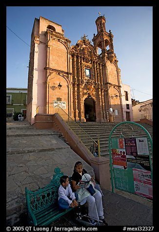 Woman and child waiting for bus below a church. Guanajuato, Mexico (color)