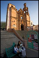 Woman and child waiting for bus below a church. Guanajuato, Mexico ( color)
