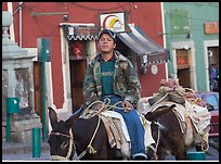 Young man riding a donkey in the streets. Guanajuato, Mexico ( color)
