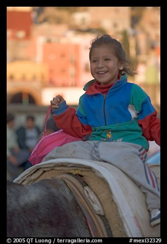 Girl riding a donkey. Guanajuato, Mexico (color)