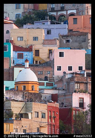 Houses painted with bright colors on a steep hillside. Guanajuato, Mexico