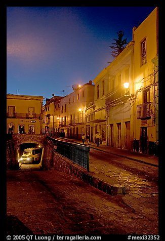 Juarez street and subterranean street with bus at night. Guanajuato, Mexico (color)