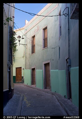 Narrow street with green houses. Guanajuato, Mexico (color)
