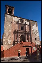 People walking in front of church San Roque, early morning. Guanajuato, Mexico ( color)