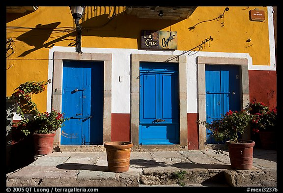Blue doors and yellow wall on Plaza San Roque. Guanajuato, Mexico (color)