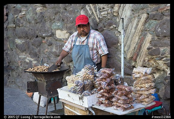 Man selling grilled peanuts on the street. Guanajuato, Mexico (color)