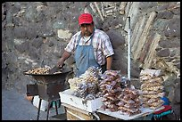 Man selling grilled peanuts on the street. Guanajuato, Mexico ( color)