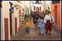 Family walking down an alley. Guanajuato, Mexico ( color)