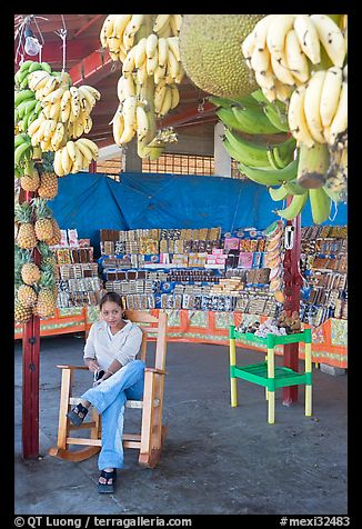Woman sitting in a fruit stand. Mexico (color)