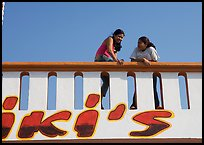 Young women sitting on a roof. Mexico ( color)