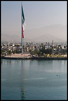 Largest Mexican flag sagging in early morning, Ensenada. Baja California, Mexico (color)