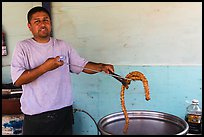 Man making churros. Baja California, Mexico ( color)