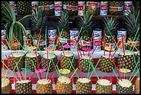 Pinacoladas prepared in pineapple shells. Baja California, Mexico (color)