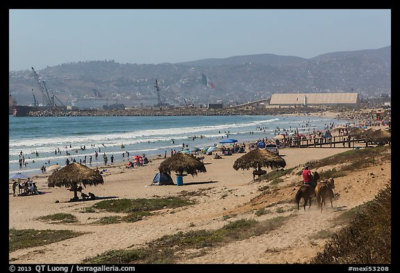 Beach With Shade Palapas And Horseman Ensenada Baja California Mexico