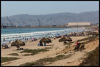 Beach with shade palapas and horseman, Ensenada. Baja California, Mexico ( color)