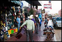 Musicians walking on street, Ensenada. Baja California, Mexico ( color)