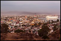 Panoramic view of city from hills at sunset, Ensenada. Baja California, Mexico (color)