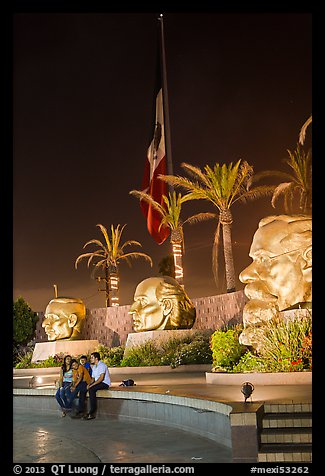 Family at Three Heads Park at night, Ensenada. Baja California, Mexico (color)