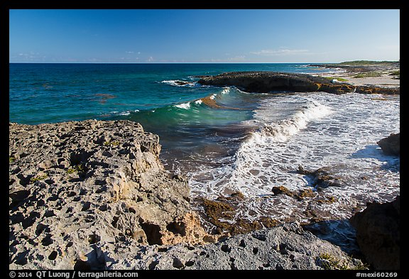 Surf and rock with holes. Cozumel Island, Mexico (color)