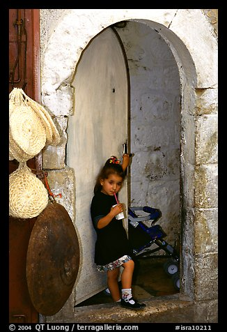 Girl in a doorway. Jerusalem, Israel (color)
