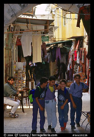 Children in a busy old town alley. Jerusalem, Israel (color)