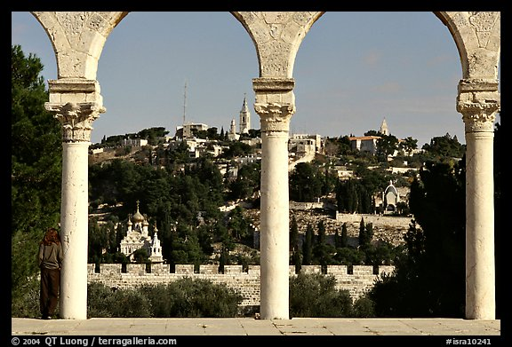 Spires and Mount of Olives seen through arches. Jerusalem, Israel (color)
