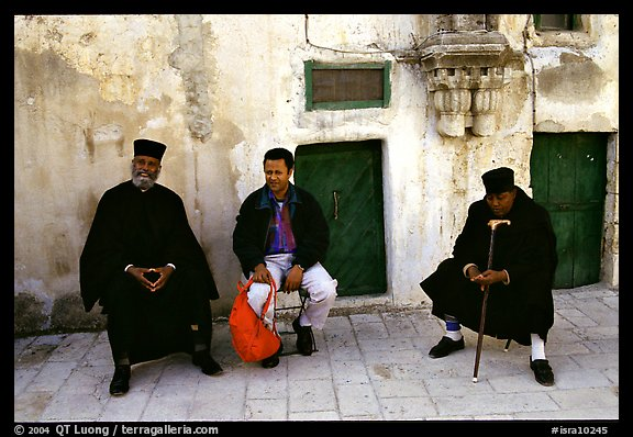 Copt monks and pilgrim in the Ethiopian Monastery. Jerusalem, Israel