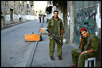 Two young israeli soldiers manning a checkpoint, Hebron. West Bank, Occupied Territories (Israel) (color)