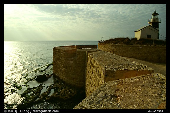 Seawall and lighthouse, late afternoon, Akko (Acre). Israel (color)