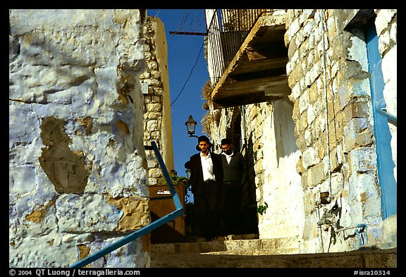Orthodox jews in a narrow alley, Safed (Tsfat). Israel (color)