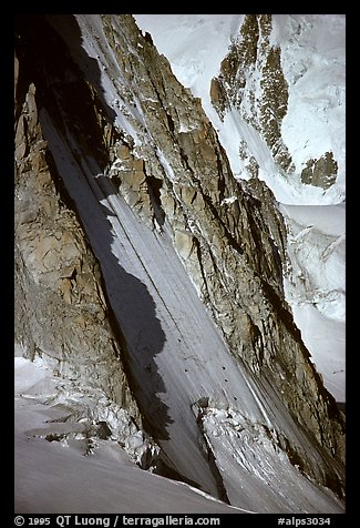 Two parties climbing on the lower half of the North face of Tour Ronde, Mont-Blanc range, Alps, France.  (color)