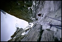 Climbers Frank and Alain climb thin ice in the Super-Couloir on Mt Blanc du Tacul, Mont-Blanc Range, French Alps