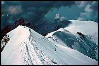 Summit ridge of Mont-Blanc and Bosses ridge with climber's trail in the snow, France and Italy. (color)