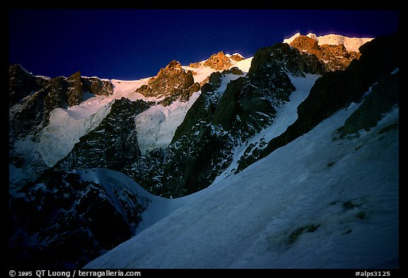 Looking up from the Red Sentinel route at dawn, Mont-Blanc, Italy.  (color)