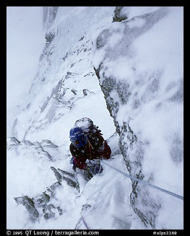 Frank Levy during a storm,  North face of Les Droites,  Mont-Blanc Range, Alps, France.  (color)