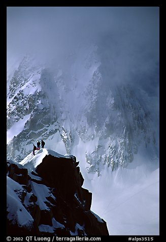 Alpinists on a buttress of Aiguille du Midi climbing the Cosmiques ridge. Alps, France (color)