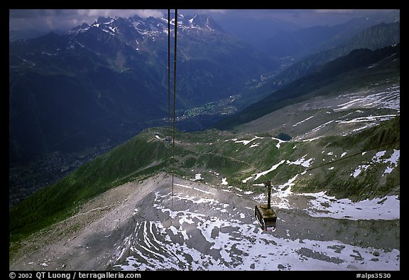 Cable car to Aiguille du Midi, Chamonix Valley in below. Alps, France (color)